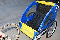 My Schwinn Spirit bike trailer before modifying it to had a wooden platform to carry cargo.