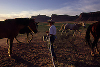 Rancher Heidi Redd feeds her horses before rounding them up to move cattle on the Dugout Ranch.  Surrounded by park and public land, the Dugout Ranch is a 5,200 acre prime piece of ranch land owned by the Nature Conservancy. Ancestral Puebloan rock art and dwellings are found through out the ranch. The property is used for ecological research, biological management, and natural and cultural history interpretation. It is being maintained as an economically viable and ecologically sustainable cattle ranching operation.