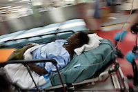 A Haitian earthquake victim is wheeled through the casualty reception area on board the USNS Comfort, a naval hospital ship, for treatment on Wednesday, January 20, 2010 in Port-Au-Prince, Haiti. The Comfort deployed from Baltimore, bringing nearly a thousand medical personnel to care for victims of Haiti's recent earthquake.