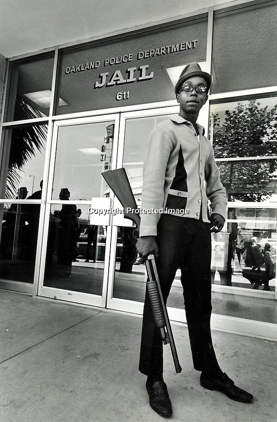 Description/Caption:<br /> Black Panther Bobby Hutton standing in front of the Oakland Police Department Jail in 1967 shortly before he was killed in a shootout with Oakland Police.<br /> (photo by Ron Riesterer) Copyright @ 2014