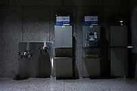 Water fountains and public telephones Inside the Tokyo Metropolitan Government Building corridors. Shinjuku, Tokyo, Japan. Friday November 11th 2011