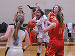 Chugiak's Chastity Horn drives through the defense of several West Valley players duiring the Mustangs' 76-28 win over West Valley. Photo by Michael Dinneen for the Star.