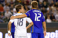 LA Galaxy forward Mike Magee has a word or two with Kansas City Wizard midfielder Jimmy Conrad while waiting for a corner kick. The Kansas City Wizards beat the LA Galaxy 2-0 at Home Depot Center stadium in Carson, California on Saturday August 28, 2010.