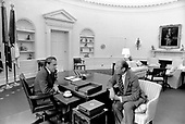United States President Richard M. Nixon, left, confers with his successor, Vice President Gerald R. Ford, right, in the Oval Office at the White House in Washington, D.C. prior to announcing his resignation on August 8, 1974.<br /> Mandatory Credit: Ollie Atkins / White House via CNP