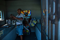 A fan takes pictures of the queen of salsa Celia Cruz mausoleum during her 10th death anniversary in the Bronx in New York,  Jul 13, 2013. Photo by Eduardo Munoz Alvarez / VIEWpress.