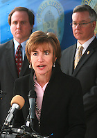 Ms. Hildy Saizow Arizona for Gun Saftey Speaking at the fourth annual Stop Random Gunfire Press Conference in Phoenix, AZ, on this Wednesday, December 29, 2010.  .Background L to R  Denis Burke U.S. Attorney AZ, .Bill Montgomery Maricopa County Attonery.Photo by AJ Alexander/AJAimages