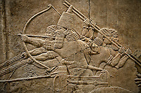 Assyrian relief sculpture panel of Ashurnasirpal on his chariot aiming an arrow during a lion hunt.  From Nineveh  North Palace, Iraq,  668-627 B.C.  British Museum Assyrian  Archaeological exhibit no ME 124867