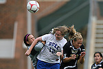 28 August 2009: Duke's Kendall Bradley (12) heads the ball over the goal between Central Florida's Aline Reis (left) and Stacie Hubbard (right). The Duke University Blue Devils lost 3-2 to the University of Central Florida Knights at Fetzer Field in Chapel Hill, North Carolina in an NCAA Division I Women's college soccer game.