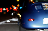 356 speedster porsche at  night with bokeh,