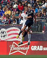 DC United defender Daniel Woolard (21) and New England Revolution midfielder Ryan Guy (13) battle for head ball. In a Major League Soccer (MLS) match, DC United defeated the New England Revolution, 2-1, at Gillette Stadium on April 14, 2012.