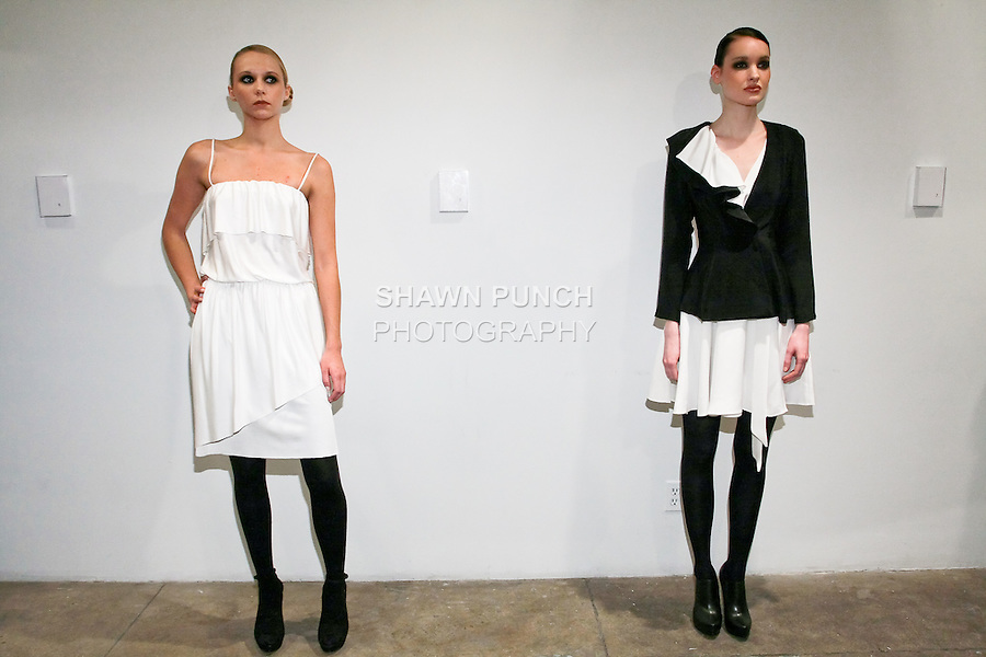 Models pose in an Ivy h. outfit, by Ivy Higa, for the Ivy h. Fall/Winter 2011 collection presentation, during New York Fashion Week Fall 2011.