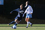 24 November 2007: Notre Dame's Kerri Hanks (2) is watched by North Carolina's Kristi Eveland (32). The University of Notre Dame Fighting Irish defeated University of North Carolina Tar Heels 3-2 at Fetzer Field in Chapel Hill, North Carolina in a Third Round NCAA Division I Womens Soccer Tournament game.