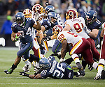 Seattle Running back Marshawn Lynch runs up the middle for 12-yard gain against the Washington Redskins in the third quarter at  CenturyLink Field in Seattle, Washington on November 27, 2011. Lynch ran for 111 yards on 24 carries and scored one touchdown in the Seattle Seahawks 17-23 loss to the Redskins. ©2011 Jim Bryant Photo. All Rights Reserved.