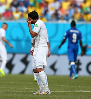 Luis Suarez of Uruguay puts his hand over his mouth