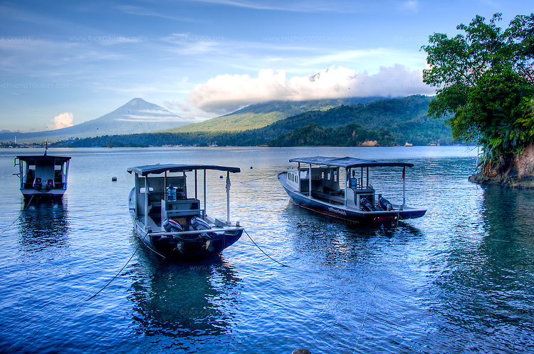 As the sun rises on the other side of Lembeh Island, gradually it illuminates the landscape of North Sulawesi, on the other side of the Lembeh Strait.  (HDR image)