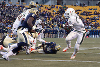 Miami running back Gus Edwards (7) scores on a 7-yard touchdown run as Pitt linebacker Todd Thomas (8) closes in too late. The Miami Hurricanes defeated the Pitt Panthers 41-31 at Heinz Field, Pittsburgh, Pennsylvania on November 29, 2013.