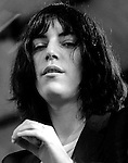 Patti Smith looks down from the stage at her concert in Central Park at the Schaeffer Music Festival at the Wollman Skating Rink in July 1976.