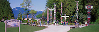 Tourists visiting Totem Poles at Brockton Point, Stanley Park, Vancouver, BC, British Columbia, Canada, Summer