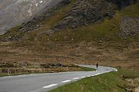 Runner entering Skjelfjord, Lofoten Ultra Marathon, 2016