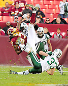 Washington Redskins tight end Fred Davis is upended by New York Jets safety Eric Smith (33) in second half action at FedEx Field in Landover, Maryland on Sunday, December 4, 2011.  The Jets won the game 34 - 19..Credit: Ron Sachs / CNP.(RESTRICTION: NO New York or New Jersey Newspapers or newspapers within a 75 mile radius of New York City)