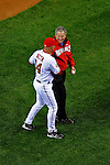 30 March 2008: United States President George W. Bush talks with Washington ationals' Field Manager Manny Acta after throwing him the ceremonial first pitch prior to the inaugural first game at Nationals Park where the Washington Nationals defeated the visiting Atlanta Braves 3-2 in Washington, DC. The win christened the new state-of-the-art ballpark with a sellout crowd of 39,389...Mandatory Photo Credit: Ed Wolfstein Photo