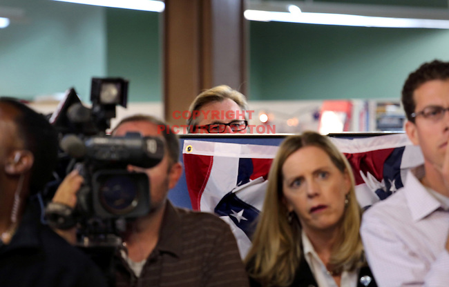 Eric Fehrnstrom, a senior advisor to Senator Scott Brown and Mitt Romney, watches Senator Brown at a morning after debate press conference this morning, September 21, 2012, at Brown's Boston headquarters. Staff photo by Mark Garfinkel
