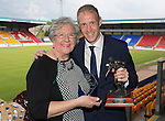 St Johnstone FC Player of the Year Awards...18.05.14<br /> George Gordon Clubman of the Year Award to Steven Anderson presnted by Gertie Gordon.<br /> Picture by Graeme Hart.<br /> Copyright Perthshire Picture Agency<br /> Tel: 01738 623350  Mobile: 07990 594431