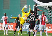 AFC Ajax goalkeeper Kenneth Vermeer (12) goes up to save the play.   AFC Ajax defeated DC United 2-1 during an International Friendly at RFK Stadium Sunday May 22, 2011.