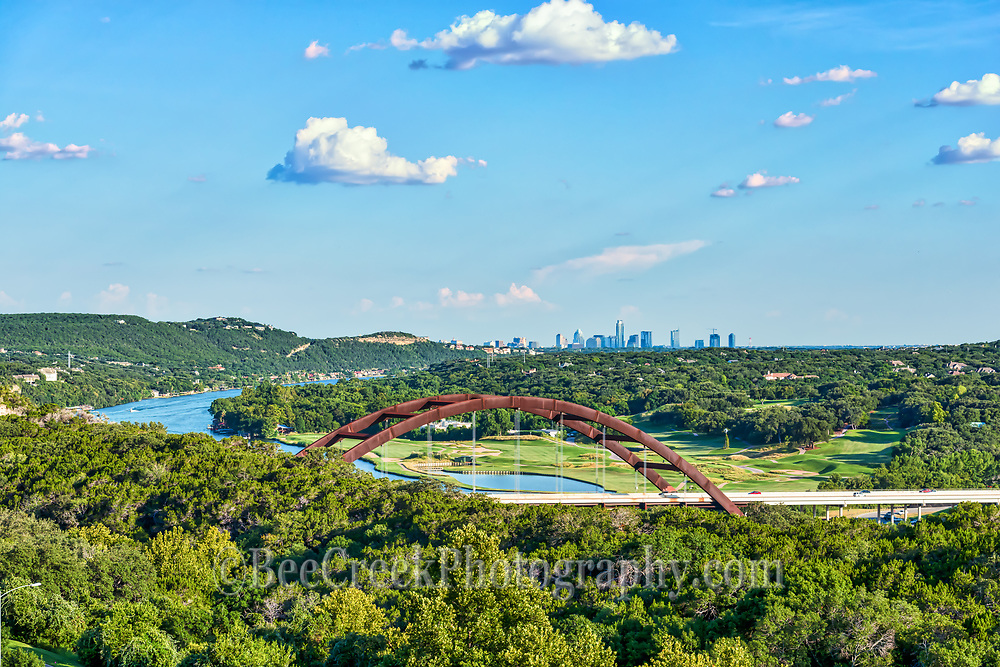 Took this day shot of the Austin Pennybacker Bridge or the 360 Bridge as many call it on a lovely day with blue sky and puffy white clouds.  You can see the Austin skyline in the background and lake Austin as it snakes through the hill country.