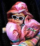 Infant with sunglasses in stroller