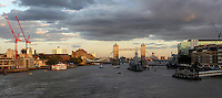 River Thames seen from London Bridge with Tower Bridge lit by the late afternoon light beneath a stormy sky in the distance, London, UK. Picture by Manuel Cohen
