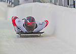 9 January 2016: Matthias Guggenberger, competing for Austria, crosses the finish line on his second run of the day during the BMW IBSF World Cup Skeleton Championships at the Olympic Sports Track in Lake Placid, New York, USA. Guggenberger ended the day with a combined 2-run time of 1:50.97 and a 13th place overall finish. Mandatory Credit: Ed Wolfstein Photo *** RAW (NEF) Image File Available ***