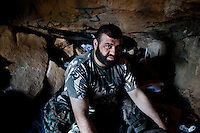 Free Syrian Army members, after another night of climbing, take a rest in natural cavities up on the mountains that surround Damascus. ALESSIO ROMENZI