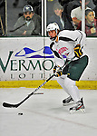 28 January 2012: University of Vermont Catamount forward Sebastian Stalberg, a Junior from Gothenburg, Sweden, in action against the visiting Northeastern University Huskies at Gutterson Fieldhouse in Burlington, Vermont. The Catamounts, dressed in their Breast Cancer Awareness jerseys, fell to the Huskies 4-2 in the second game of their 2-game Hockey East weekend series. Mandatory Credit: Ed Wolfstein Photo