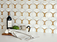 Calla, a handmade mosaic shown in honed Lavigne and polished Cloud Nine, is part of the Miraflores Collection by Paul Schatz for New Ravenna.<br />