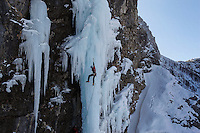 Marco Prezelj, reknown ice climber and mountain guide climbing an ice candle in Triglavski National Park in Slovenia