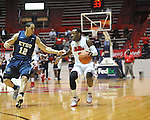 "Ole Miss' Derrick Millinghaus (3) vs. East Tennessee State's Yunio Barrueta (12) at the C.M. ""Tad"" Smith Coliseum in Oxford, Miss. on Saturday, December 14, 2012. Mississippi won 77-55 to improve to 7-1. (AP Photo/Oxford Eagle, Bruce Newman).."