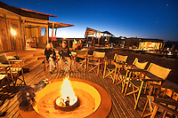 Guests at campfire, Wolwedans Dunes Lodge, NamibRand Nature Reserve, Namibia
