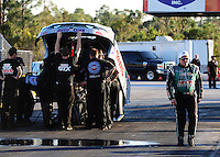 Jan. 19, 2012; Jupiter, FL, USA: NHRA funny car driver John Force (right) walks past the car of daughter Courtney Force during testing at the PRO Winter Warmup at Palm Beach International Raceway. Mandatory Credit: Mark J. Rebilas-