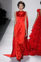 Model walks runway in a ruby couture silk satin column gown w/beaded imperial muical garland court train from the Zang Toi Fall 2012 &quot;Glamour At Gstaad&quot; collection, during Mercedes-Benz Fashion Week New York Fall 2012 at Lincoln Center.