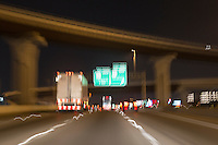 Traffic speeds up and down I-35 under the US 290 interchange  in downtown Austin, Texas