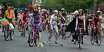 A silver painted skateboarder weaves his way through a group of painted bikers during the 21st Annual Fremont Summer Solstice Parade in Seattle on June 20, 2009. The parade was held Saturday, bringing out painted and naked bicyclists, bands, belly dancers and floats. (Jim Bryant Photo © 2009)