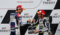 Yamaha MotoGP rider Jorge Lorenzo of Spain (Left) and Yamaha MotoGP rider Valentino Rossi of Italy toss with champagne after the 2013 Australian Motorcycle Grand Prix in Phillip Island, Oct 20, 2013. Photo by Daniel Munoz/VIEWpress IMAGE RESTRICTED TO EDITORIAL USE ONLY- STRICTLY NO COMMERCIAL USE.