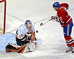 3 February 2007: New York Islanders' Rick DiPietro (39) blocks a shot by Montreal Canadiens center Saku Koivu (11) of Finland in the first period at the Bell Centre in Montreal, Canada. The Islanders defeated the Canadiens 4-2.Mandatory Photo Credit: Ed Wolfstein Photo *** Editorial Sales through Icon Sports Media *** www.iconsportsmedia.com