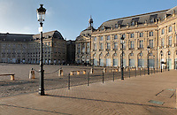 Place de la Bourse (Stock Exchange Square) or Place Royale, built 1730-55 by architect Ange-Jacques Gabriel during the reign of King Louis XV, Bordeaux, Aquitaine, France. The royal square is a symmetrical rectangular space with the Stock Exchange to the North, Farms Hall to the East, a central building to the West and the Garonne River to the South. The square forms part of the Port of the Moon and is listed as a UNESCO World Heritage Site, and the buildings are listed as historic monuments. Picture by Manuel Cohen