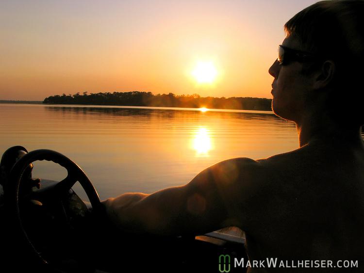 Fishing on Lake Jackson as he sun sets.