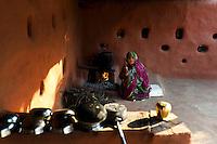 Bishnoi lady cooks at her home in Guda Bishnoi village near Jodhpur in Rajasthan, India. Arindam Mukherjee