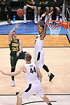 MILWAUKEE, WI - MARCH 16:  Vermont Catamounts guard Ernie Duncan (20) shoots on the run during the second half of the 2017 NCAA Men's Basketball Tournament held at BMO Harris Bradley Center on March 16, 2017 in Milwaukee, Wisconsin. (Photo by Jamie Schwaberow/NCAA Photos via Getty Images)