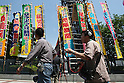 May 27, 2010 - Tokyo, Japan - Cameramen walk past the Ryogoku Kokugikan, also known as Sumo Hall, in Tokyo, Japan, on May 27, 2010. The Japan Sumo Association decided punishments on Thursday against two sumo stable masters in connection with the distribution of front-row tickets to several high-ranking members of a gang affiliated with the Yamaguchi-gumi crime syndicate.