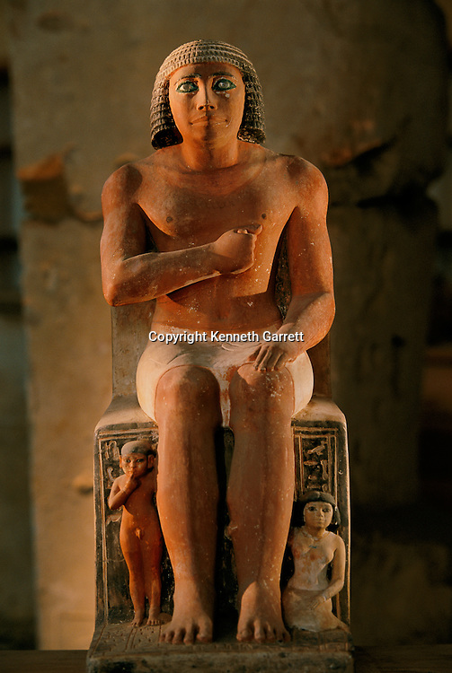 Painted limestone statue of Kai with inlaid crystal eyes and his children at this feet, Old Kingdom